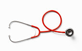Red stethoscope on white background. Health concept. Horizontal composition with clipping path and copy space. Directly above.