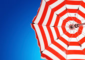 Red umbrella in the mediterranean sea