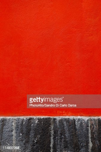 Red stucco wall, close-up