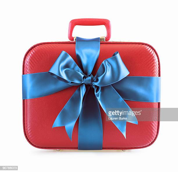 Red Suitcase Wrapped in Blue Ribbon