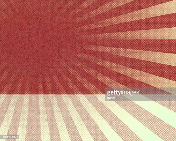 red sunburst halftone pattern on paper