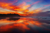 red sunset in Sopelana beach with reflections;