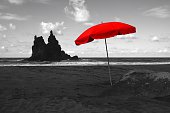 Red Sunshade On Beach Against Sky