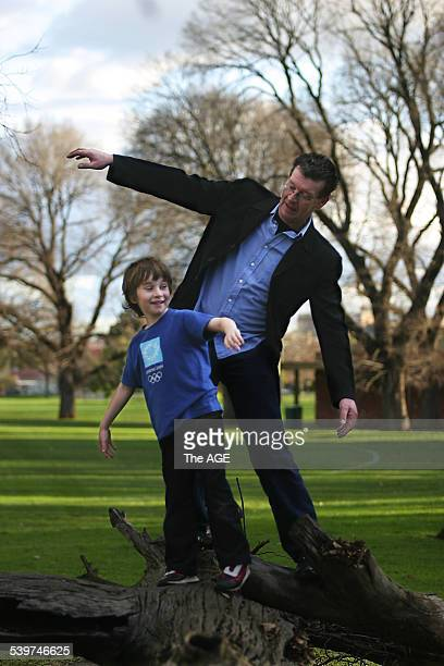 Red Symons who quit smoking one year ago plays in a Melbourne park with his son Joel 28 July 2005 The Age Picture by NIC KOCHER