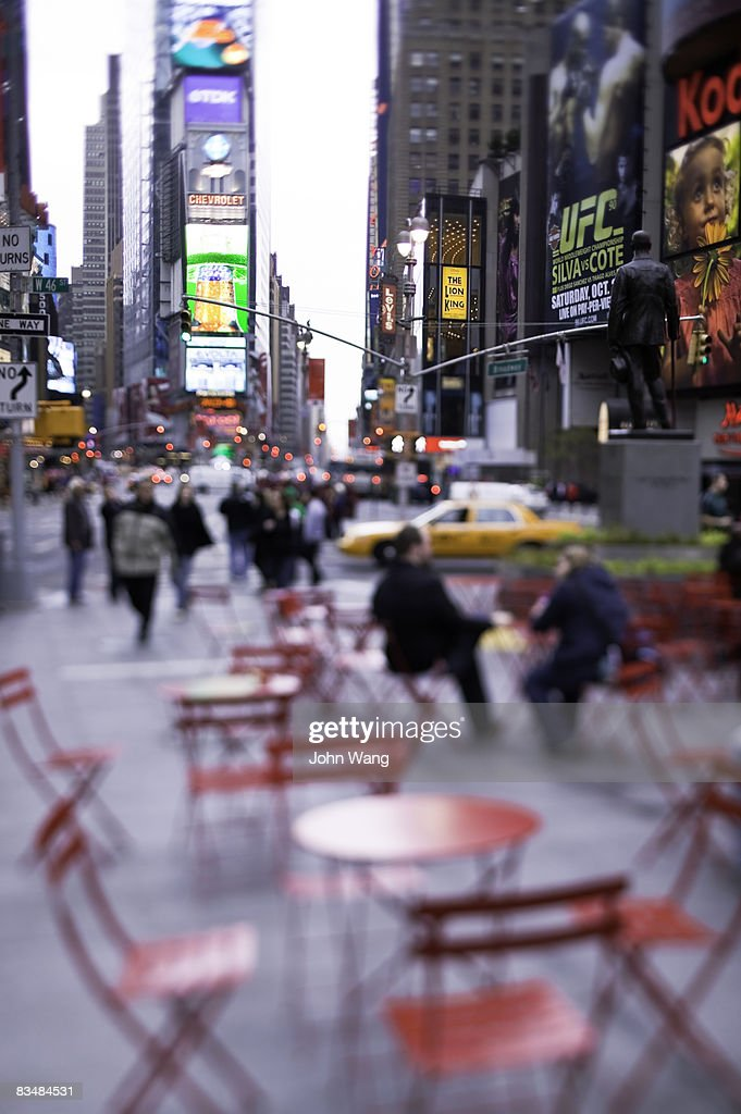 red tables and chairs at the Time Square : Stock Photo