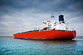 Red tanker ship afloat in the ocean