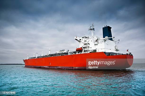 Red tanker ship afloat in the ocean