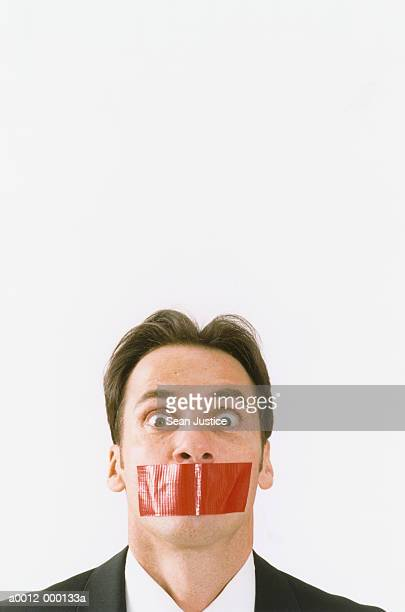 Red Tape Covering Man's Mouth