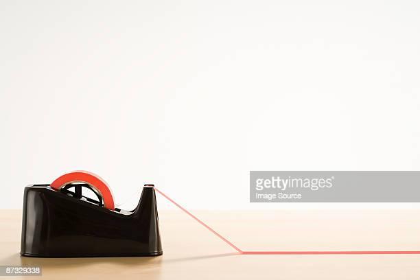 Red tape on desk