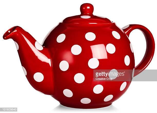 Red tea pot with white polka-dot pattern