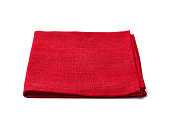 Red textile napkin isolated on white background