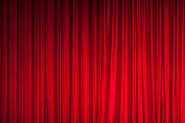 Background of red spotted real theatrical curtain or drapes texture