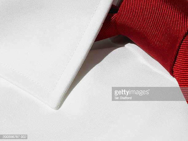 Red tie on white shirt, close-up