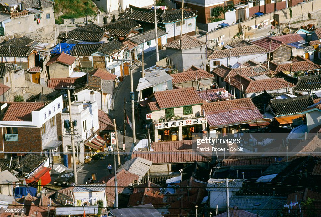 Red tile roofs top the stores and homes in a neighborhood of Seoul.