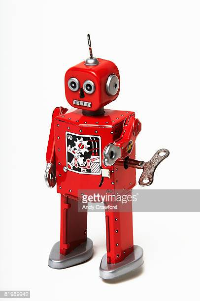 Red tin wind-up robot toy