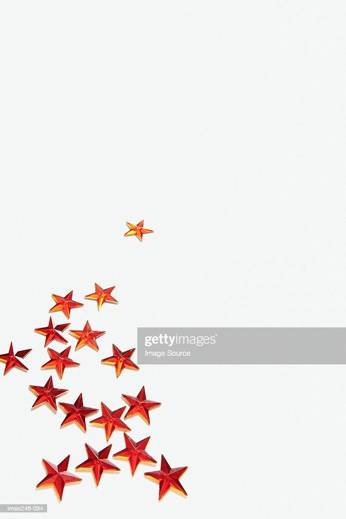 Red tinsel stars