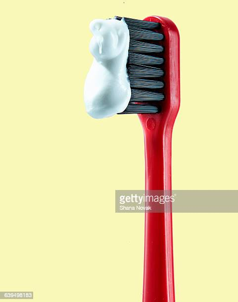 Red Toothbrush with Paste