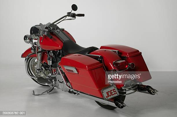 Red touring motorcycle parked in studio