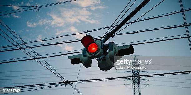 Red traffic light at dusk