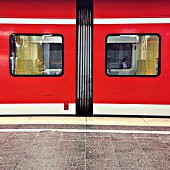 Red Train At Railroad Station