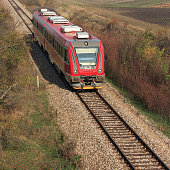 Modern red diesel train on the rails travel fast every day