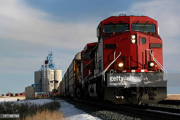 Red train on tracks in Alberta, Canada