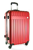 Red color travel suitcase isolated on white background.