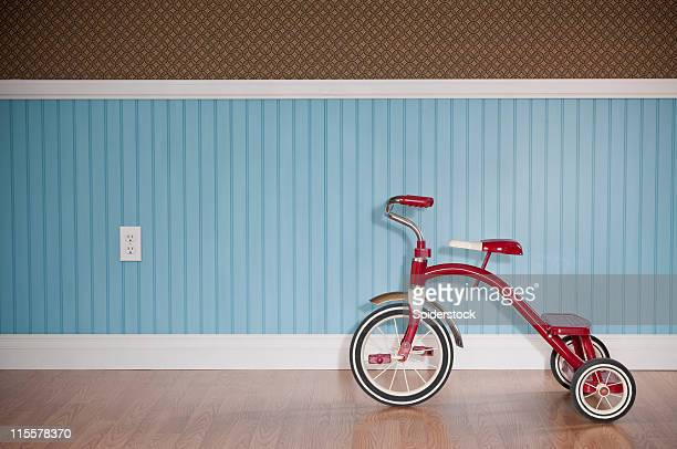 Red Tricycle In Empty Room