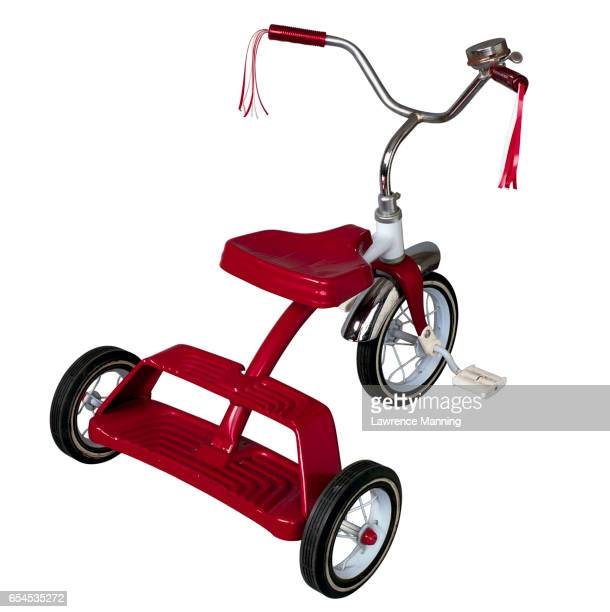 Red Tricycle with Tasseled Handlebars
