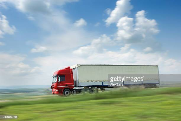 Red truck going fast on a highway