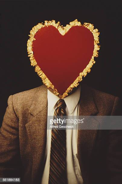 A red Valentine's Day heart superimposed over a man's face 1984