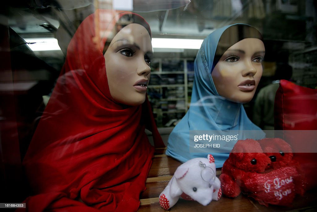 Red veils are displayed at a clothes shop for Muslim women on Valentine's Day in Beirut's Muslim Basta neighbourhood on February 14, 2013. Valentine's Day is increasingly popular in the region as people have taken up the custom of giving flowers, cards, chocolates and gifts to sweethearts to celebrate the occasion.