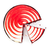 Red velvet cake with wedge cut.  Top view, isolated on white.