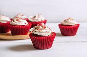 Red velvet cupcake on white wooden table