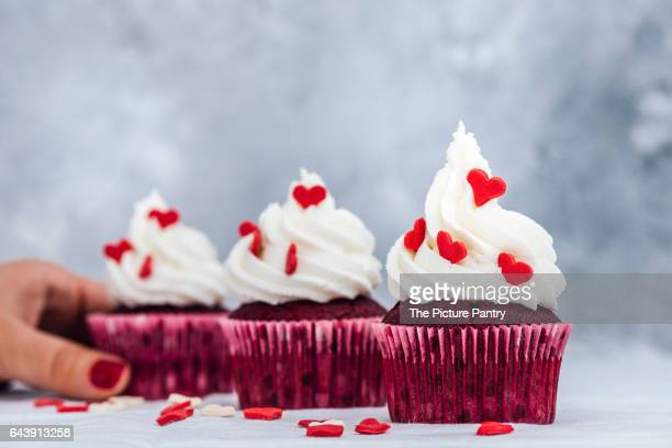 Red velvet cupcakes with buttercream frosting and decorated with heart ...