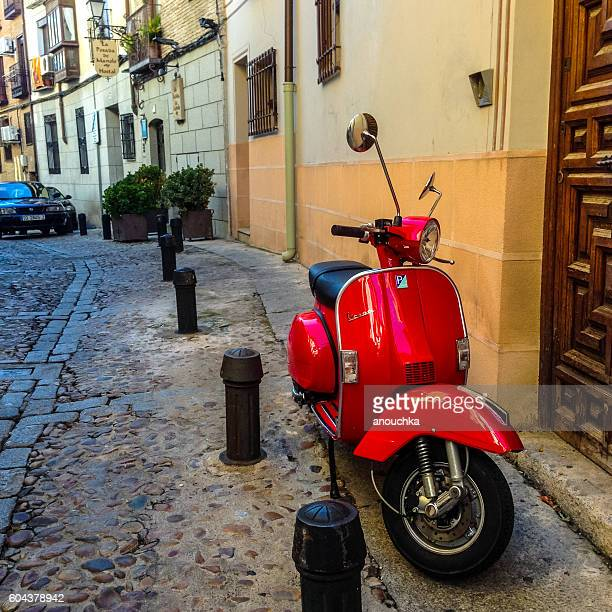 Red Vespa parked on Toledo street, Spain