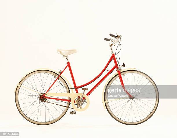 Red vintage bike against white background.