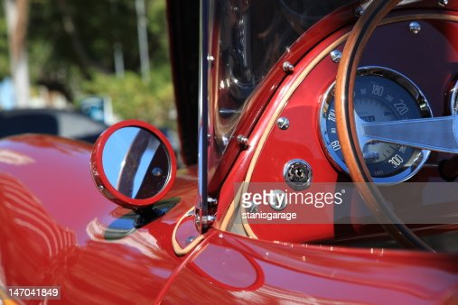 Red Vintage Car With Wood Steering Wheel Stock Photo Thinkstock