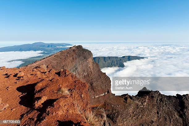 Red volcanic rock on the summit, Piton des Neiges Mountain, 3069 m, above the clouds, near Cilaos, French Overseas Territory, La Reunion