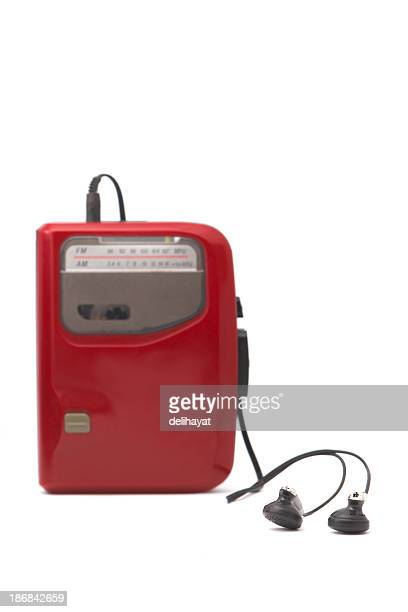 A red Walkman with headphones against a white background