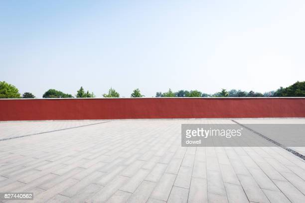 red wall and empty floor