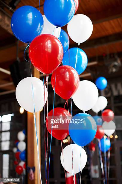 Red white and blue balloons party setup