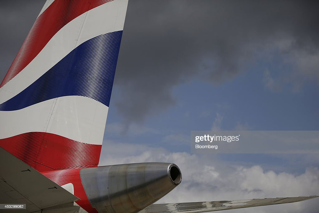 A red white and blue livery sits on the tailfin of a British Airways passenger jet operated by IAG SA at London City Airport Ltd in London UK on...