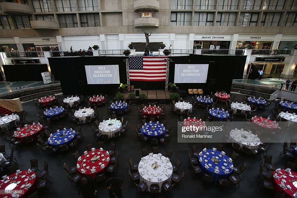 Red, white and blue tables are prepared before the 40th annual U.S. Hockey Hall of Fame Induction Ceremony & Dinner at Plaza of the Americas on October 15, 2012 in Dallas, Texas.