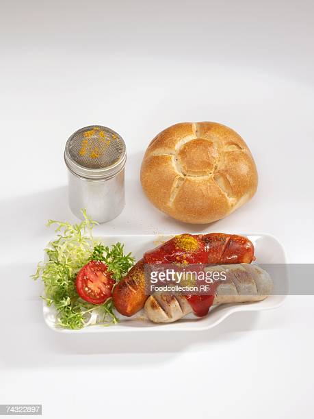 Red & white currywurst (sausages with ketchup & curry powder), bread roll