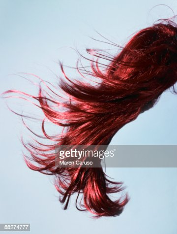 Red wig of hair flying in the wind