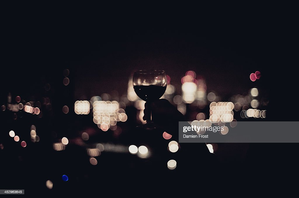 Red Wine and City Lights : Stock Photo