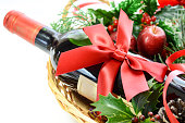 red wine bottle in a basket for Christmas party in white background