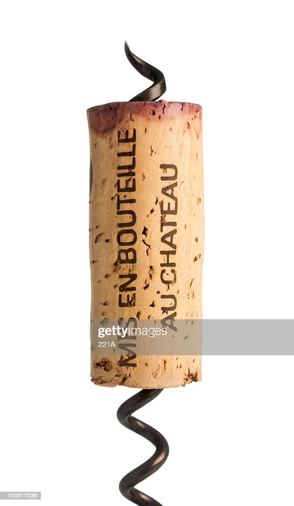 Red wine cork and corkscrew on white