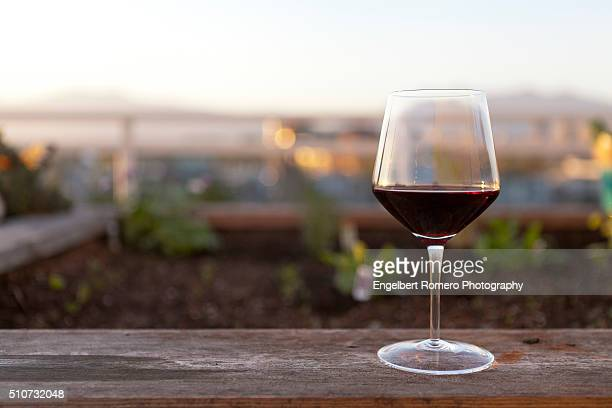 Red wine glass by the ledge